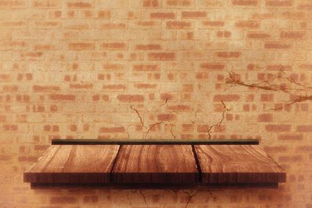 the shelf: Wooden shelf against bricks and crack wall Stock Photo