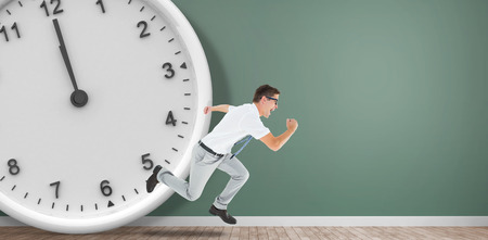 rushing hour: Geeky happy businessman running mid air in front of a clock