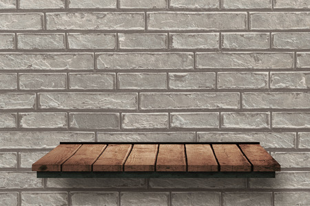 the shelf: Wooden shelf against bricks wall Stock Photo