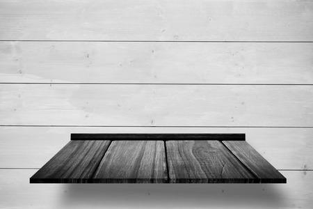 wooden shelf: Wooden shelf against white wooden wall