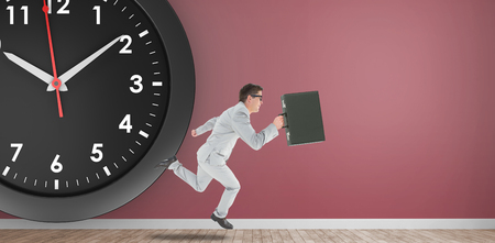 running businessman: Running businessman on a pink room and in front of a clock