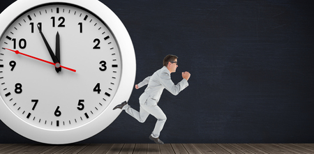 rushing hour: Geeky happy businessman running mid air on a black room and in front of a clock
