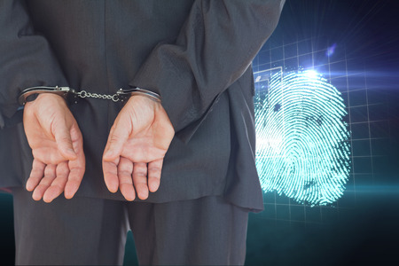 restraining device: Businessman in handcuffs against digital security finger print scan
