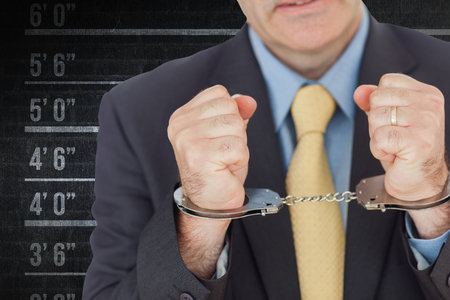 restraining device: Closeup of businessman with handcuffed hands against digital composite image of height measurement