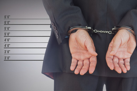 Closeup of handcuffed businessman against digitally generated image of height measurement