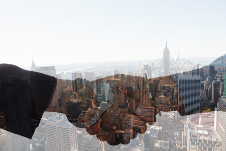 restraining device: Business people in handcuffs shaking hands against new york skyline Stock Photo