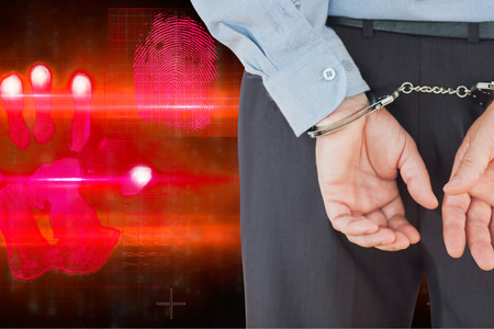 formals: Businessman in formals with handcuffs against red technology hand print design