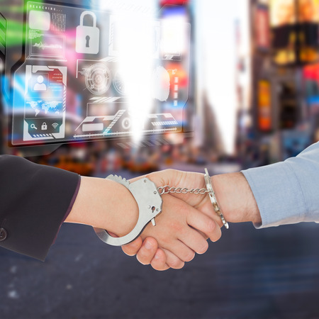 restraining device: Business people in handcuffs shaking hands against blurry new york street