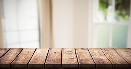 abode: Wooden table against living room Stock Photo