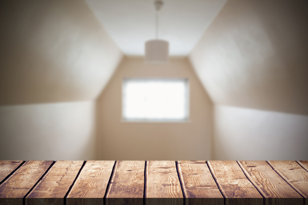 attic room: Wooden table against empty attic room in cream and beige Stock Photo