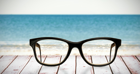 reading glasses: Reading glasses against a picture of a beach