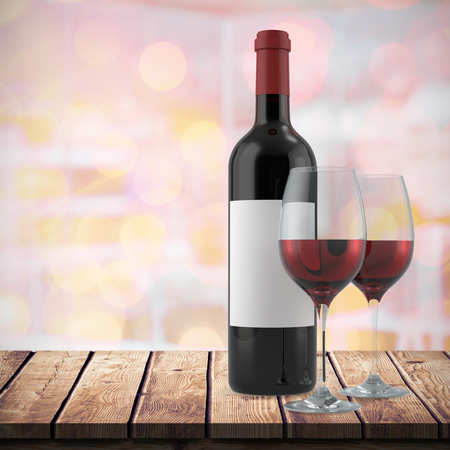 red wine: Red wine against glowing background Stock Photo