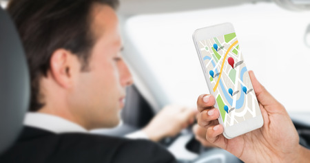 drivers seat: Cropped image of businesswoman holding smart phone against businessman in the drivers seat Stock Photo