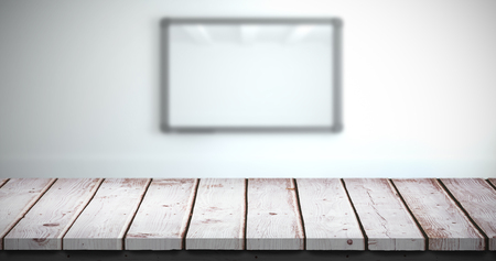 abode: Wooden table against screen in modern white room