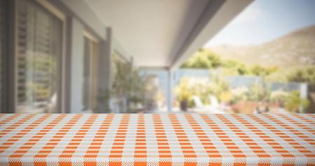 domicile: Composite image of orange and white tablecloth