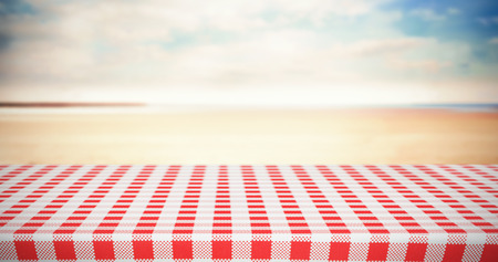 tablecloth: Red and white tablecloth against serene beach landscape