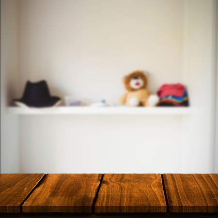 abode: Wooden table against a shelf with some objects