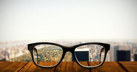 homely: Reading glasses against new york Stock Photo