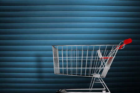 shutters: Shopping cart against grey shutters