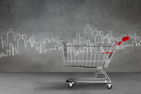 caddy: Shopping cart against hand drawn city plan