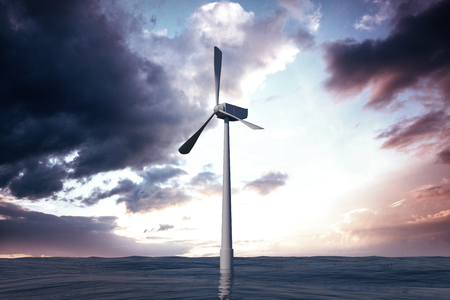 casual business team: A wind turbine is working against cloudy sky Stock Photo