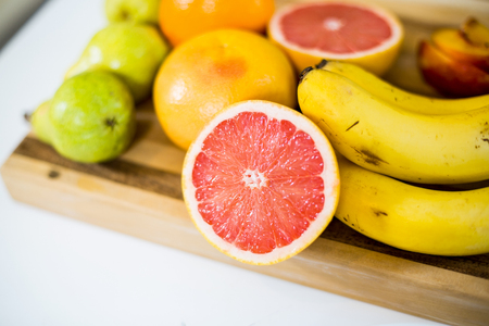 domiciles: Close-up of fruits on chopping board in kitchen at home