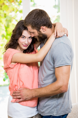 Young couple embracing each other at home Stock Photo