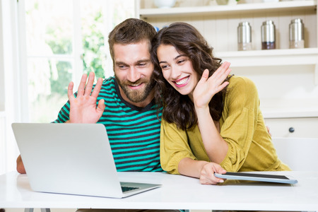 video chat: Couple having video chat on laptop at home