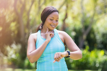 Happy woman posing and looking her watch Stock Photo
