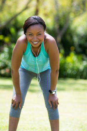 lonesomeness: Happy woman posing at park