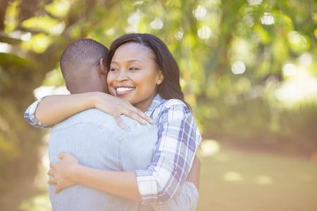 young adult woman: Happy couple having hug Stock Photo