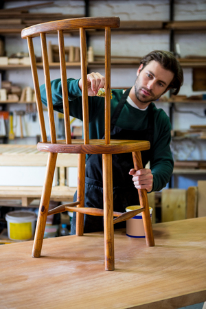 carpenter's bench: Carpenter working on his craft in a dusty workshop