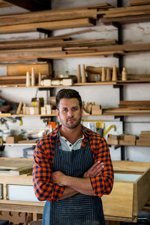 crossing arms: Carpenter crossing arms in his workshop Stock Photo