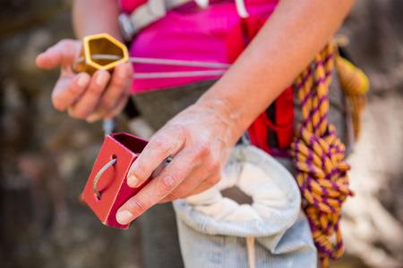 adventuring: Close up climbing equipment on a woman