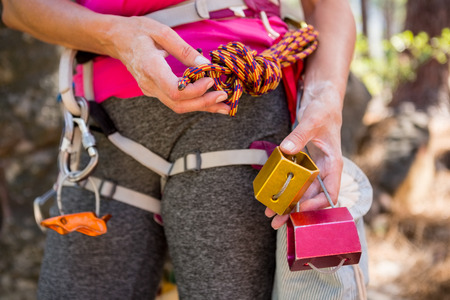 abseiling: Close up climbing equipment on a woman