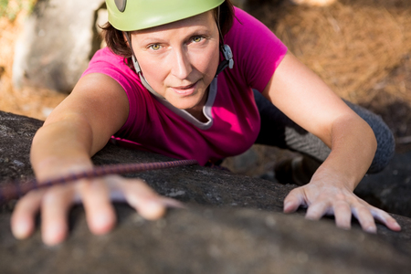abseiling: Woman rock climbing on the nature Stock Photo