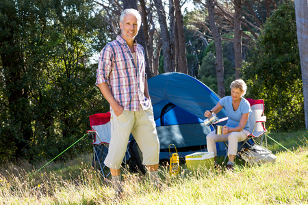 campsite: Mature couple posing on their campsite