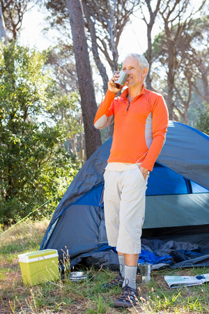 campsite: Mature man drinking on a mug on campsite