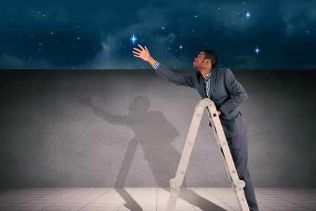 black professional: Businessman climbing up ladder against stars twinkling in night sky