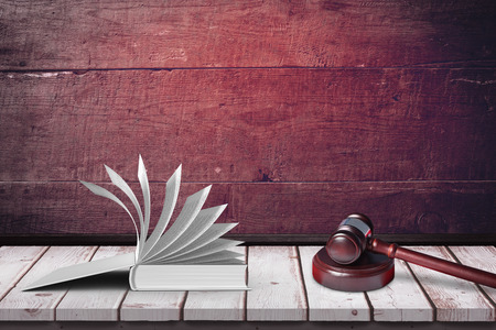 two objects: Open book against a wall
