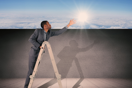 concentrating: Businessman climbing up ladder against blue sky over clouds at high altitude