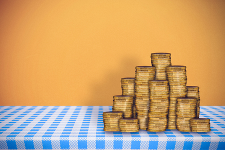 gold table cloth: Stack of gold coins against orange background