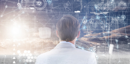 looking at view: wear view of businessman looking across window  against hologram background Stock Photo