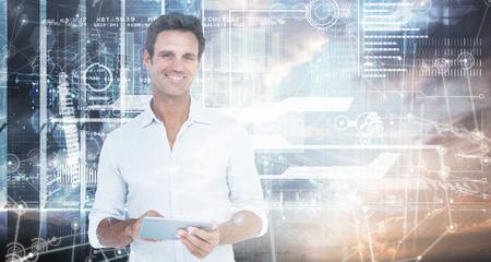 mature men: Portrait of smiling man using digital tablet against hologram background