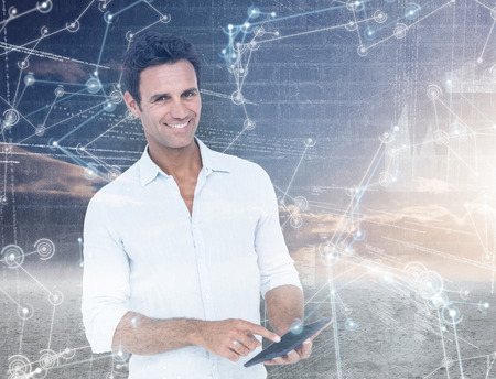 tablet computer: Portrait of smiling man using tablet computer against hologram background