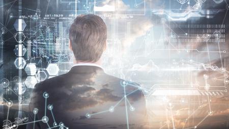 mid adult men: Rear view of handsome businessman  against hologram background