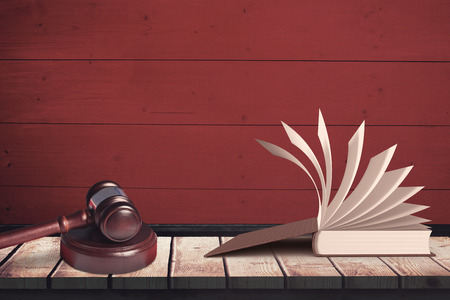 two objects: Open book against a red wall
