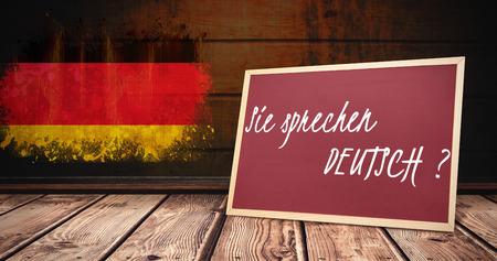 deutsch: sie sprechen deutsch against germany flag in grunge effect Stock Photo