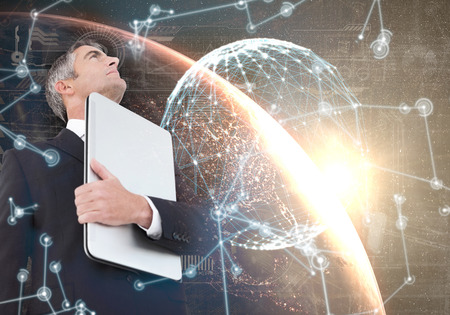 hologram: Businessman in suit holding his laptop proudly against hologram background Stock Photo