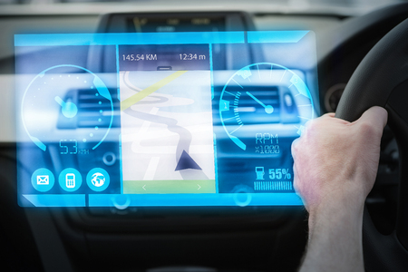windshield wiper: Image of a map against close up of man using satellite navigation system Stock Photo